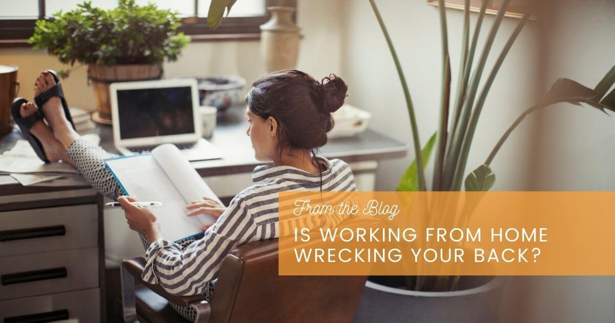 Woman in desk chair.