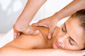 Woman receiving a therapeutic massage
