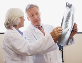 Two doctors reviewing x-ray