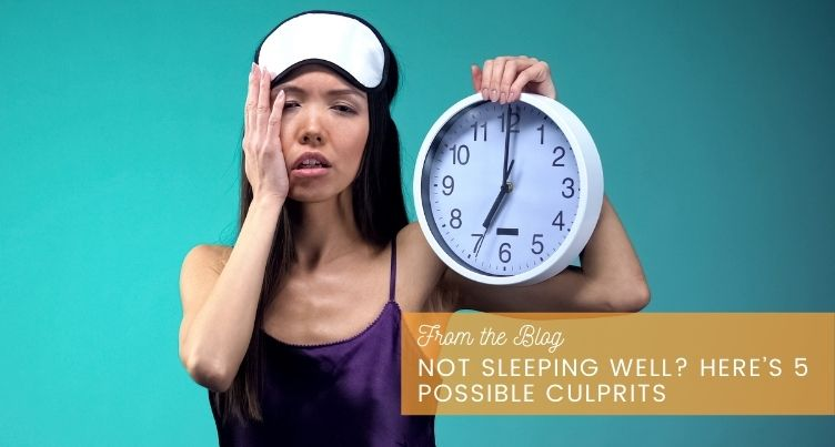 Tired woman holding clock.