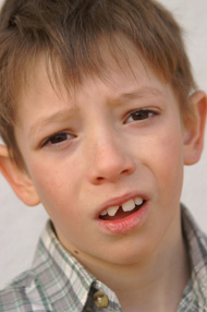 Young boy with chipped tooth
