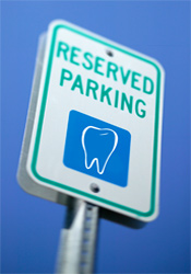 Reserved parking sign with tooth