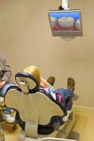 Dental patient watching a interactive patient education video