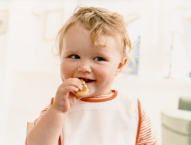Cute young child eating a snack