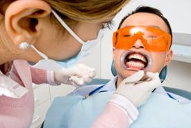 Patient receiving laser tooth-whitening procedure