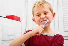 Young boy brushing his teeth in the bathroom