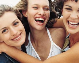 Three smiling teenage girls