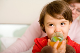 Child drinking juice from a bottle