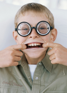 Young boy with goggles on making a funny face