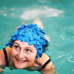 Smiling senior woman in pool