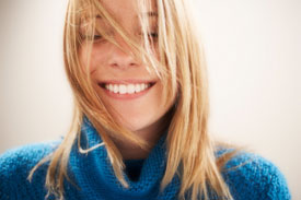 Smiling woman wearing invisible braces