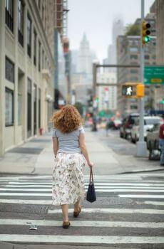 Woman crossing street.