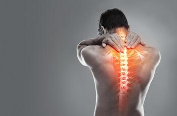 Man grabbing spine.
