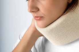 Unhappy woman in cervical collar