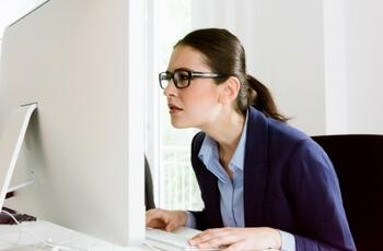 Woman squinting at computer