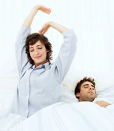 Woman stretching after a good nights sleep