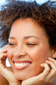 Woman smiling with hands on her cheeks