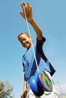 Boy playing with a yo-yo