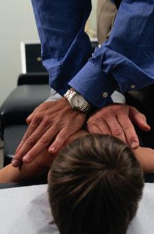 Doctor adjusting boy