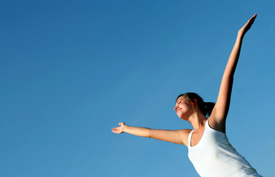 Girl with arms outstretched in the sun