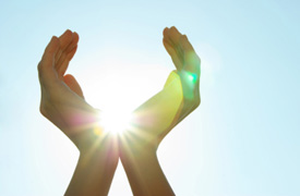 Hands holding Sun