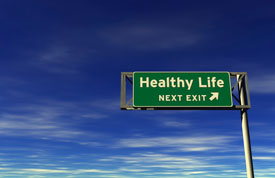 Sign saying Healthy Life Next Exit