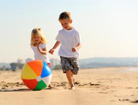 Children running on a beach