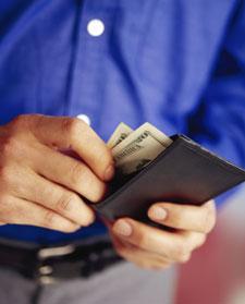 Man pulling money from wallet