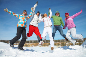 people jumping in snow