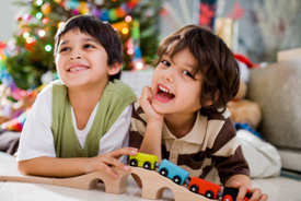 boys play with holiday gifts