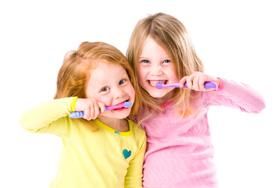 Two little girls brushing teeth