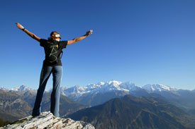 Woman standing on mountain top