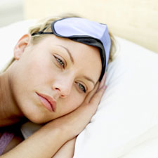 woman with insomnia laying in bed