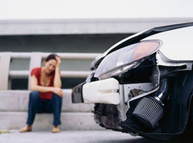 Woman upset from auto accident