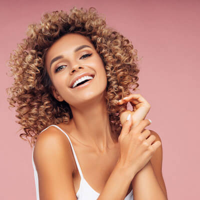 Beautiful happy woman with curly hair