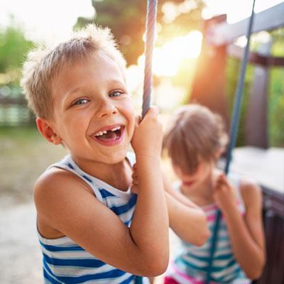 Boy on swing smiling