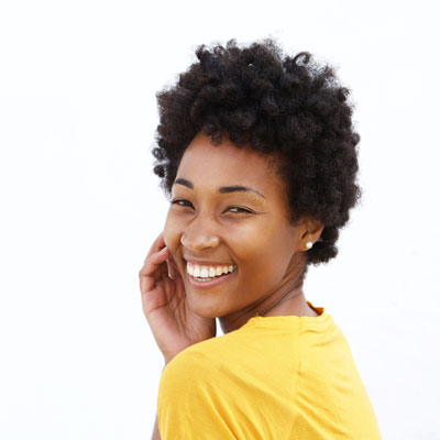 Woman with dark skin and beautiful smile