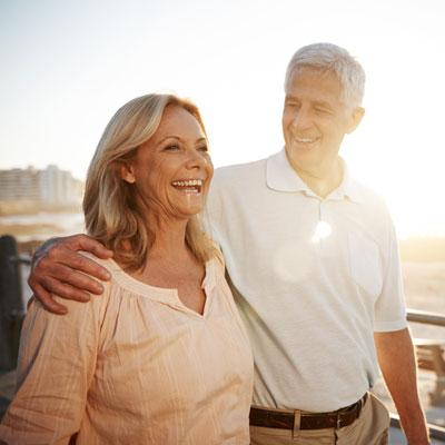 Man and woman walking outdoors at sunset