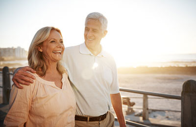 Couple walking outdoors at sunset