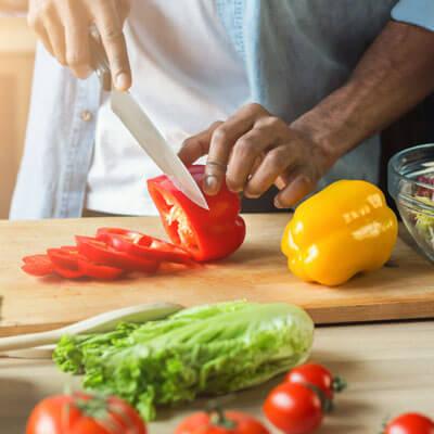 Man cutting up pepper