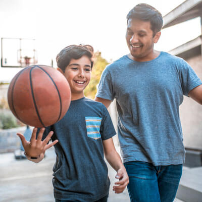 Dad and son with basketball