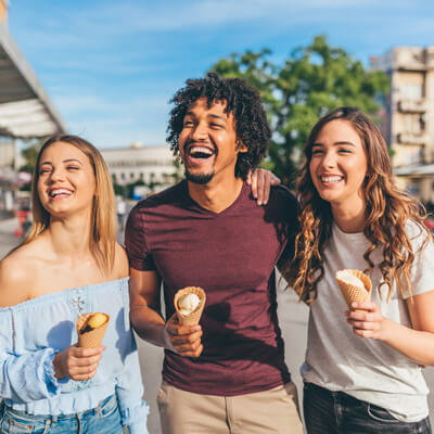 Young people eating ice cream and laughing