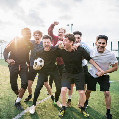 Men excited playing soccer
