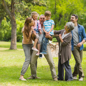 Happy, smiling multi-generational family outdoors in park
