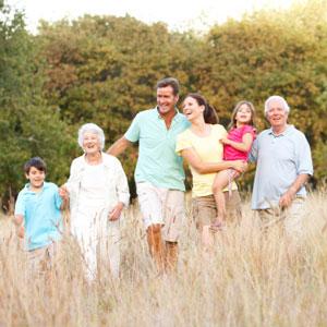 Multigenerational family walking in grass