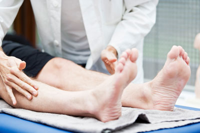 Doctor checking patients feet