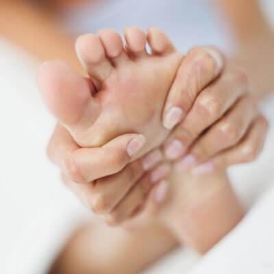 Woman getting foot massaged