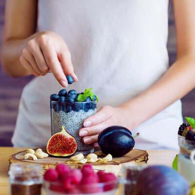 Woman preparing fruit cup