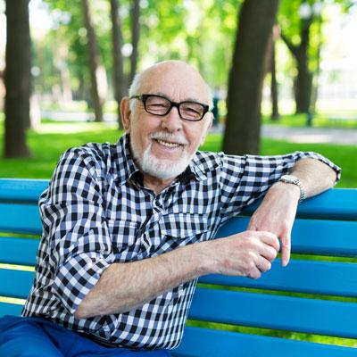 Man sitting on blue chiar