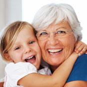 Little girl hugging elderly woman